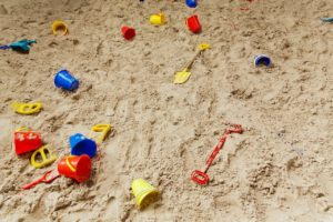 Sandbox filled with toys.
